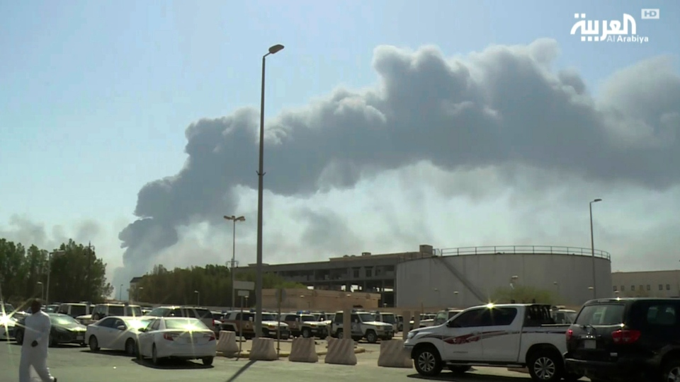 In this Saturday, Sept. 14, 2019 file photo, made from a video broadcast on the Saudi-owned Al-Arabiya satellite news channel, smoke from a fire at the Abqaiq oil processing facility fills the skyline, in Buqyaq, Saudi Arabia. (Al-Arabiya via AP, File)