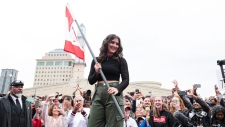 Bianca Andreescu takes part in the SheTheNorth rally after winning the US Open, in Mississauga, Ont., on Sunday, Sept. 15, 2019. THE CANADIAN PRESS/Christopher Katsarov