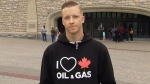 Chris Wollin said a security officer told him to remove his pro-oil and gas shirt while visiting Ottawa's Parliament.