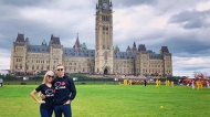 Chris Wollin and his fiancé Mallory Hartviksen were touring Parliament Hill when they say they were told they weren't allowed to wear t-shirts that visibly expressed support for the Canadian oil and gas industry. (Courtesy: Chris Wollin)