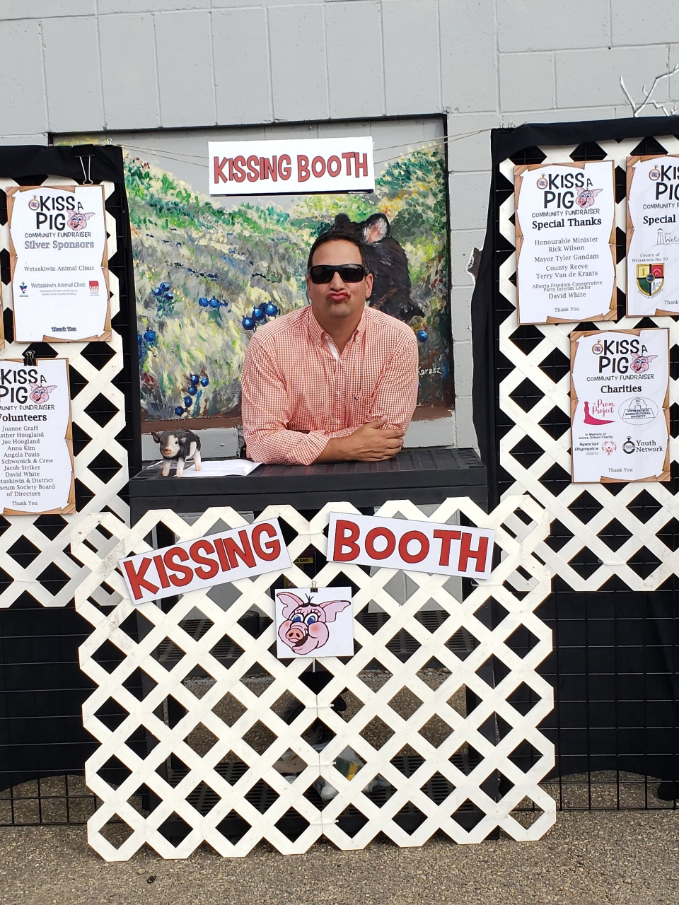 "Mayor Tyler Gandam was one of several dignitaries taking part in the ""Kiss a Pig"" community fundraiser. (Courtesy: Angela Pauls)"