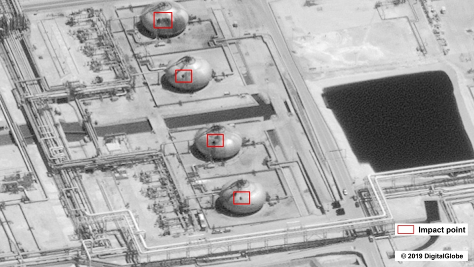 This image provided on Sept. 15, 2019, by the U.S. government and DigitalGlobe and annotated by the source, shows damage to the infrastructure at Saudi Aramco's Abaqaiq oil processing facility in Buqyaq, Saudi Arabia.  U.S. government / Digital Globe via AP)