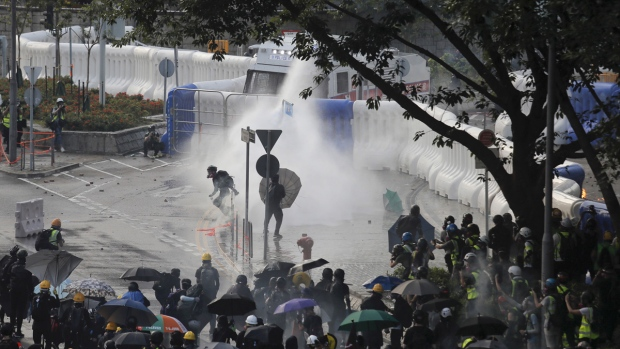 Anti-government protesters sprayed by water cannon