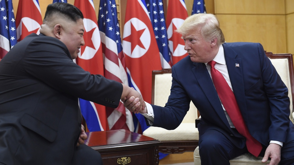 FILE - In this June 30, 2019, file photo, U.S. President Donald Trump meets with North Korean leader Kim Jong Un at the border village of Panmunjom in the Demilitarized Zone, South Korea. (Susan Walsh / AP)