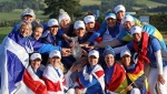Team Europe celebrate with the Solheim Cup after their victory against the US at Gleneagles, Auchterarder, Scotland, Sunday, Sept. 15, 2019. (AP Photo/Peter Morrison)
