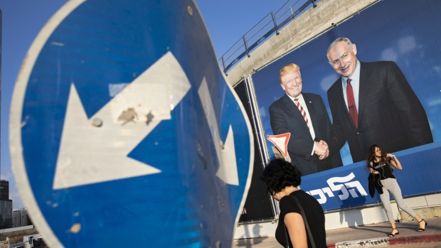 An election campaign billboard for the Likud party shows Israeli Prime Minister Benjamin Netanyahu, right, and U.S. President Donald Trump, in Tel Aviv, Israel, on Sept 15, 2019. (Oded Balilty / AP)