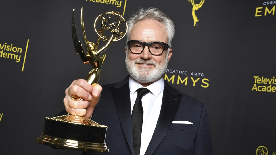 Bradley Whitford poses for a portrait with the award for outstanding guest actor in a drama series for 'The Handmaid's Tale', 'Postpartum' at the 2019 Creative Arts Emmy Awards on Sept. 15, 2019. (Vince Bucci / Invision for the Television Academy / AP)