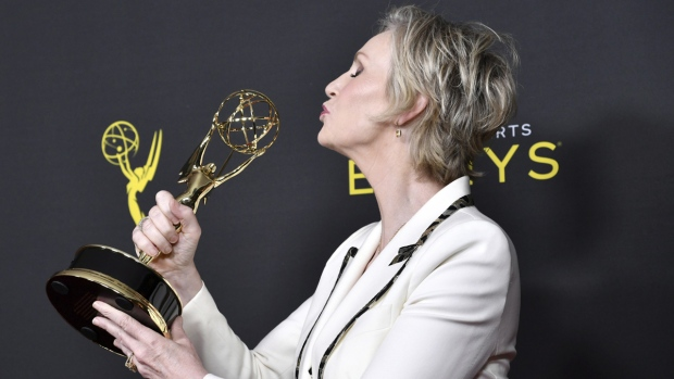 Jane Lynch poses with her Emmy
