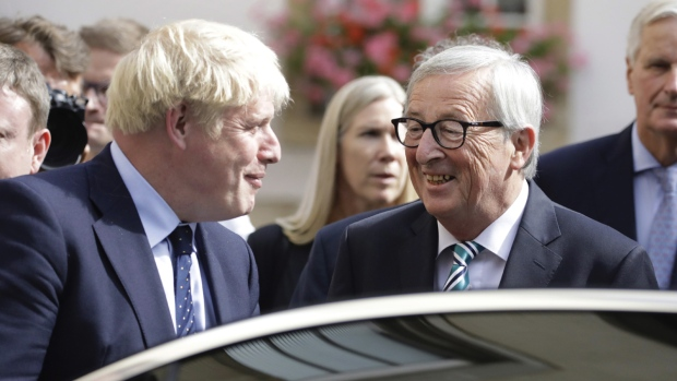 British Prime Minister Boris Johnson, left, and European Commission President Jean-Claude Juncker, centre, depart after a meeting in Luxembourg, on Sept. 16, 2019. (Olivier Matthys / AP)