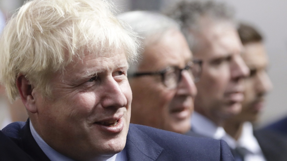 British Prime Minister Boris Johnson, left, departs after a meeting with European Commission President Jean-Claude Juncker in Luxembourg, on Sept. 16, 2019. (Olivier Matthys / Ap)
