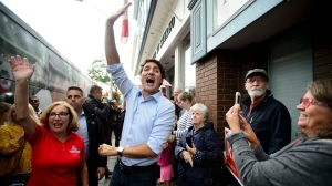 Liberal Leader Justin Trudeau is raising 'one hand up' yesterday, which is also the title of the Strumbellas poorly translated campaign song. THE CANADIAN PRESS/Sean Kilpatrick