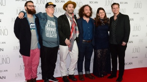 The Strumbellas pose for photographers as they arrive for the Juno Gala awards show in Ottawa, Saturday April 1, 2017. (THE CANADIAN PRESS / Sean Kilpatrick)