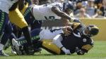 Pittsburgh Steelers quarterback Ben Roethlisberger (7) is sacked by Seattle Seahawks defensive end Rasheem Green (98) and Jadeveon Clowney in the first half of an NFL football game, Sunday, Sept. 15, 2019, in Pittsburgh. (AP  / Gene J. Puskar)