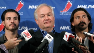 In this Sept. 12, 2012, file photo, National Hockey League Players' Association executive director Donald Fehr, center, is joined by players George Parros , left, and Kevin Westgath after meeting with NHL officials in New York.  (AP Photo/Mary Altaffer, File)