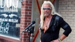 "Duane ""'Dog the Bounty Hunter' Chapman talks to reporters outside his storefront Friday, Aug. 2, 2019, in Edgewater, Colo.  (AP Photo/David Zalubowski)"