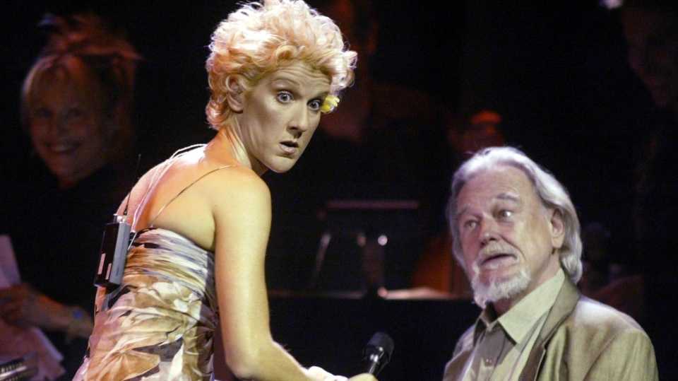 Singer songwriter Celine Dion jokes around with jazz pianist Vic Vogel at a gala event honouring songwriter Eddy Marnay, in Gatineau, Que., Wedneday, July 9, 2003. (THE CANADIAN PRESS / Tom Hanson)