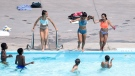People jump into a public pool in Montreal, Monday, August 6, 2018. THE CANADIAN PRESS/Graham Hughes
