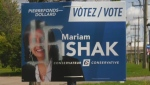 Several of Mariam Ishak's posters have been defaced with swastikas