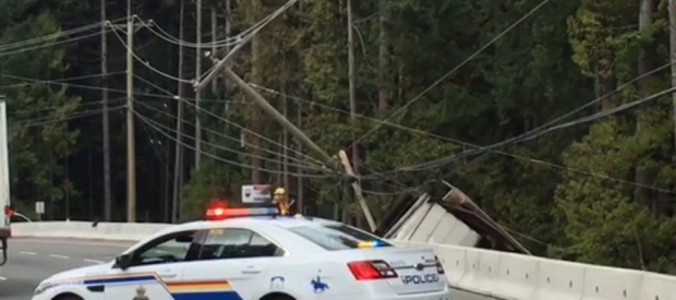 Traffic is stopped in both directions at Aspen Road, where the semi-truck crash occurred. (CTV Vancouver Island)