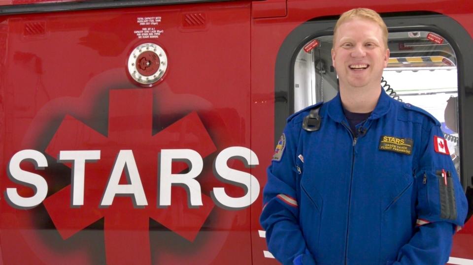 Jason Trask in front of an air ambulance at the hangar in Saskatoon. (Laura Woodward/CTV Saskatoon)