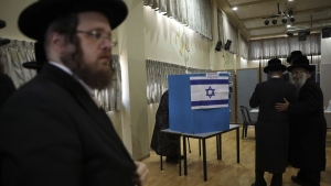 Ultra orthodox Jews wait for Rabbi Israel Hager to vote in Bnei Brak, Israel, Sept. 17, 2019. (Oded Balilty / AP)