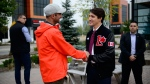 Liberal Leader Justin Trudeau talks to a voter in Kitchener, Ont., on Monday, Sept. 16, 2019. THE CANADIAN PRESS/Sean Kilpatrick