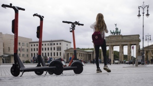 Electric scooters stand in front of the Brandenburg Gate and wait for customers in Berlin, Germany, on Sept. 17, 2019. (Markus Schreiber / AP)