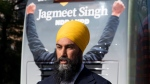 NDP leader Jagmeet Singh speaks to the media beside the campaign bus during a stop in Montreal, Monday, September 16, 2019. (THE CANADIAN PRESS / Adrian Wyld)