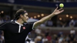 Roger Federer tosses the ball for a serve during the quarterfinals of the U.S. Open tennis tournament on Sept. 3, 2019. (Seth Wenig / AP)