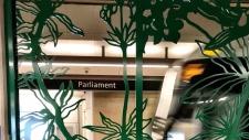 An Allstom Citadis Spirit train enters Parliament station framed by the work of Jennifer Stead. (Graham Richardson/CTV Ottawa)