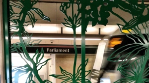 An Allstom Citadis Spirit train enters Parliament station framed by the work of Jennifer Stead. (Graham Richardson/CTV Ottawa)