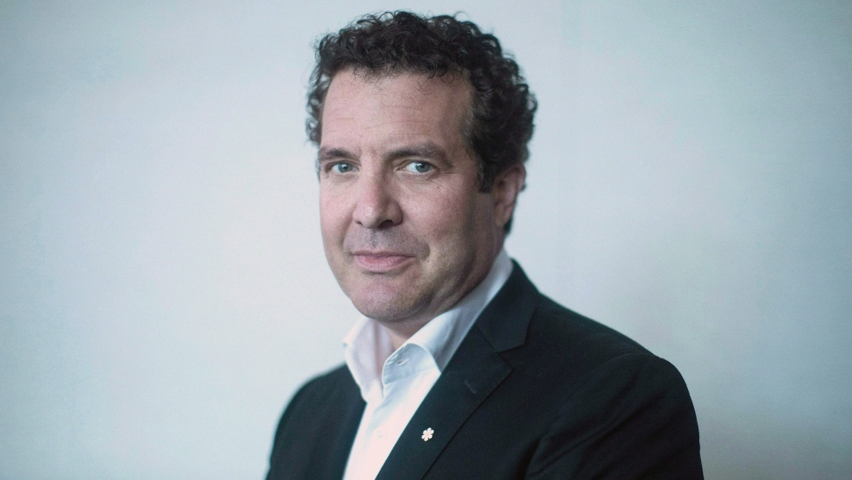 Rick Mercer poses for a photo in his publisher's Toronto office as he promotes his new book