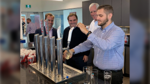 The first pour of beer at the Molson Coors Fraser Valley Brewery with Brewer Nick Muzzin at the taps, flanked by Chairman of the Molson Coors Brewing Company Board - Andrew Molson, board member Geoff Molson and Vice-Chairman Pete Coors. (Molson Coors Canada)