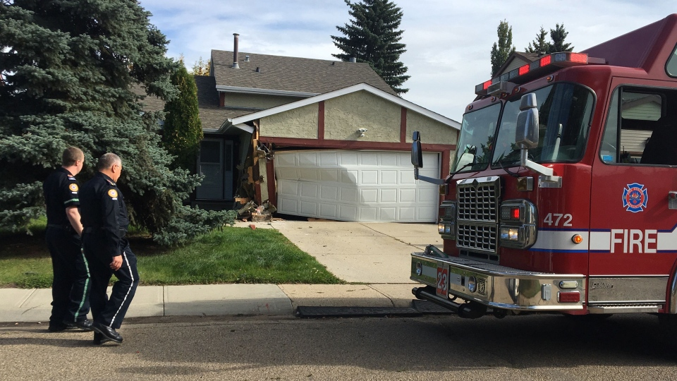 A home in west Edmonton was damaged after it was hit by a truck on Tuesday. (John Hanson/CTV News Edmonton)