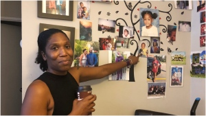 Raechon Elahie points to a picture of her son Jonathan Davis who was killed on Saturday. (CTV News Toronto)