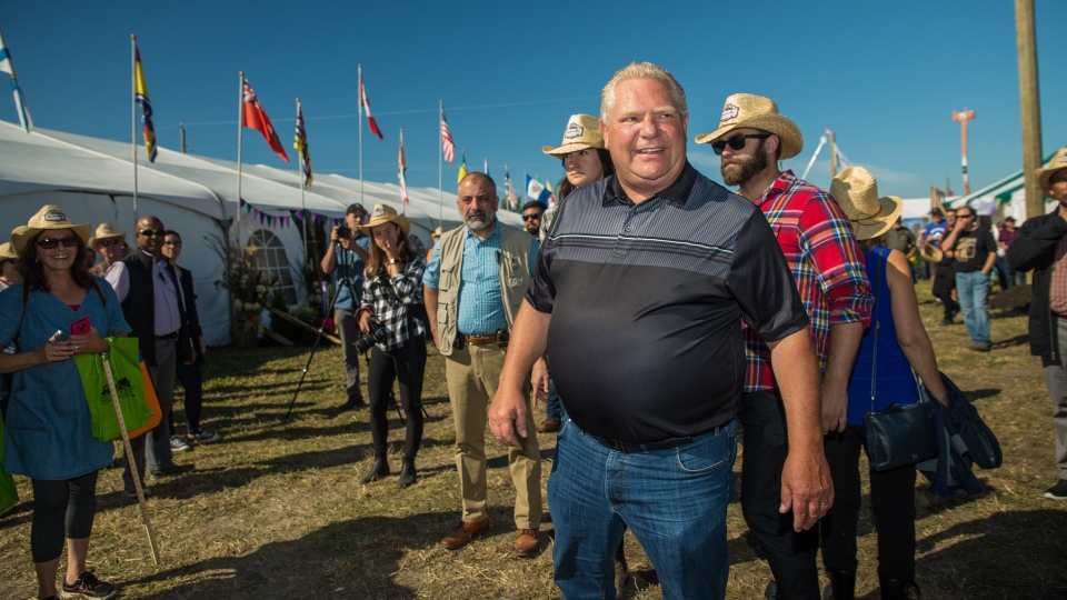 Ontario Premier Doug Ford welcomes visitors to the International Plowing Match in Verner, Ont. during the opening parade on Tuesday, September 17, 2019. THE CANADIAN PRESS/Vanessa Tignanelli