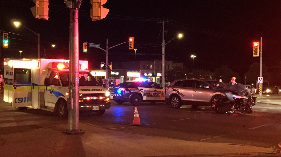 Regional Police say two people were taken to hospital after a motorcycle and SUV collided in Kitchener Tuesday night. (Terry Kelly / CTV Kitchener)