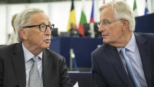 European Commission president Jean-Claude Juncker, left, speaks whith European Union chief Brexit negotiator Michel Barnier on Sept. 18, 2019 at the European Parliament in Strasbourg, France. (Jean-Francois Badias / AP)