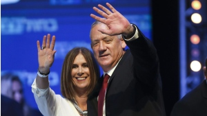 Blue and White party leader Benny Gantz and his wife Revital wave to supporters at party headquarters in Tel Aviv, Israel, on Sept. 18, 2019. (Oded Balilty / AP)