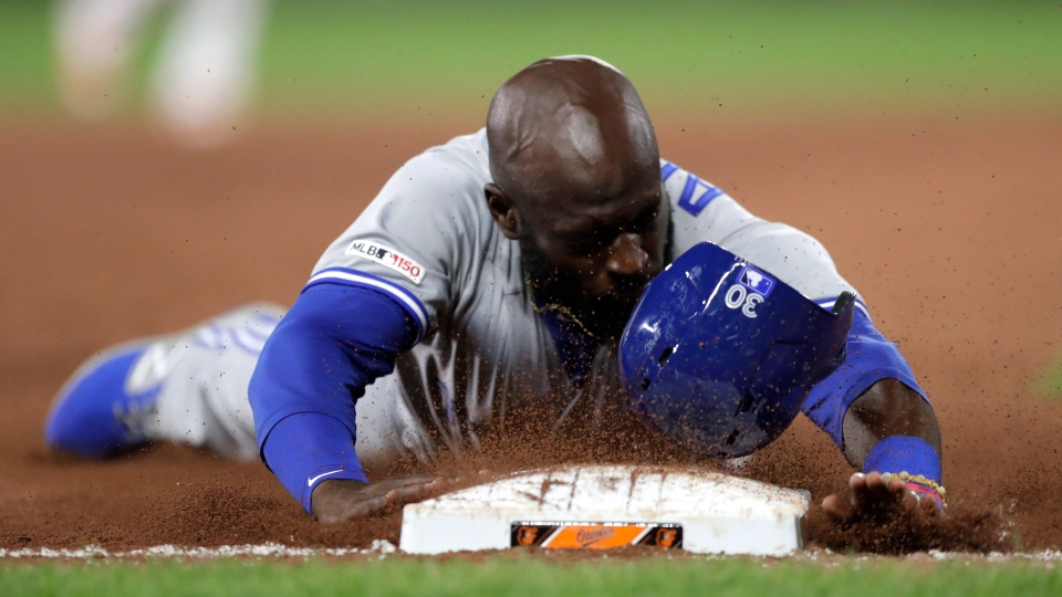 Toronto Blue Jays' Anthony Alford slides safely onto third base on a single by Vladimir Guerrero Jr. during the ninth inning of a baseball game against the Baltimore Orioles, Tuesday, Sept. 17, 2019, in Baltimore. The Blue Jays won 8-5. (AP Photo/Julio Cortez)