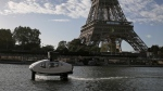 SeaBubbles co-founder Sweden's Anders Bringdal aboard a SeaBubble by the Eiffel Tower on the river Seine, on Sept. 18, 2019 in Paris.  (Francois Mori / AP)