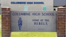 This June 13, 2019, file photo shows signs outside Columbine High School in Littleton, Colo. (AP Photo/David Zalubowski, File)