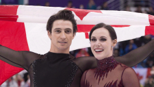 Ice dance gold medallists Canada's Tessa Virtue and Scott Moir skate with the Canadian flag during victory ceremonies at the Pyeongchang Winter Olympics Tuesday, February 20, 2018 in Gangneung, South Korea. On Friday, Virtue and Moir were rewarded for their historic comeback performance at the Pyeongchang Olympics by winning the The Canadian Press team of the year for 2018. THE CANADIAN PRESS/Paul Chiasson