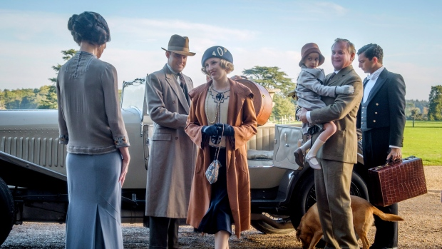 """This image released by Focus features shows Elizabeth McGovern, from left, Harry Hadden-Paton, Laura Carmichael, Hugh Bonneville and Michael Fox, right, in a scene from """"Downton Abbey."""" (Jaap Buitendijk/Focus Features via AP)"""