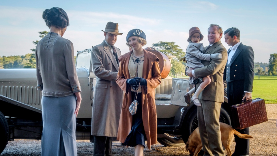 "This image released by Focus features shows Elizabeth McGovern, from left, Harry Hadden-Paton, Laura Carmichael, Hugh Bonneville and Michael Fox, right, in a scene from ""Downton Abbey."" (Jaap Buitendijk/Focus Features via AP)"