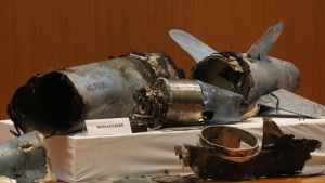 Remains of what was described as a misfired Iranian cruise missile used in an attack that targeted the heart of Saudi Arabia's oil industry, displayed during a press conference in Riyadh, Saudi Arabia, on Sept. 18, 2019. (Amr Nabil / AP)
