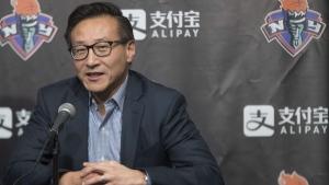 Joe Tsai speaks to reporters