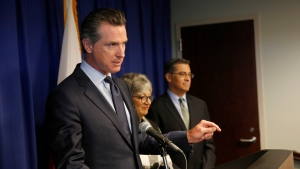 Gov. Gavin Newsom, left, flanked by California Air Resources Board Chair Mary Nichols and California Attorney General Xavier Becerra, discusses the Trump administration's pledge to revoke California's authority to set vehicle emissions standards that are different than the federal standards, during a news conference in Sacramento, Calif., Wednesday, Sept. 18, 2019. (AP Photo/Rich Pedroncelli)