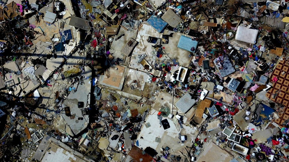 The rubble of a destroyed neighborhood stands in the aftermath of Hurricane Dorian in Abaco, Bahamas, Tuesday, Sept. 17, 2019. (AP Photo/Ramon Espinosa)