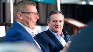 Saskatchewan Premier Scott Moe laughs as Alberta Premier Jason Kenney looks on during a joint panel discussion held in the Weyburn Curling Rink at the Saskatchewan Oil & Gas Show in Weyburn, Sask. on Wednesday June 5, 2019. (THE CANADIAN PRESS / Michael Bell)